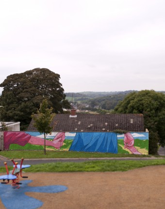 "Image: View from childrens' play park of the finished ""Community Spirit"" mural at Marian Park, Downpatrick. © copyright David McClelland 2016. All rights reserved"