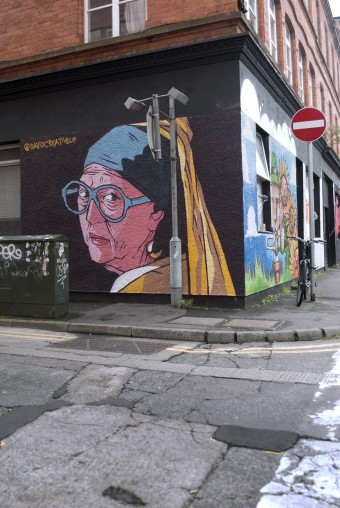 "Image: Photograph of the finished ""Nan with Pearl Earring"" mural on the corner of Union Street and Kent Street, Belfast. © copyright David McClelland 2016. All rights reserved"